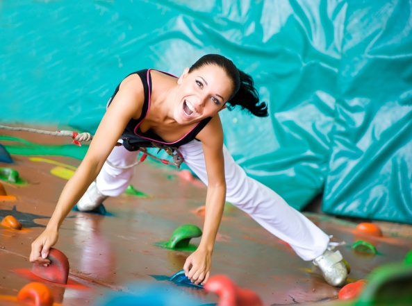 bigstock-women-climbing-on-a-wall-23819783